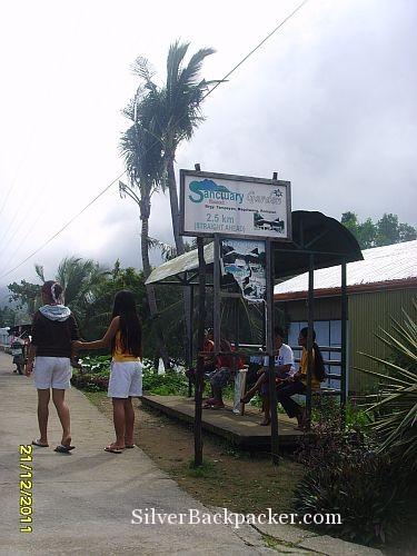 Roadside sign for Sanctuary Garden Resort