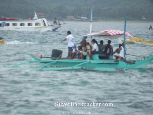 Boats ferry passengers to Caticlan Unseen Boracay