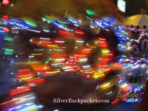 Lights of a speeding rickshaw in the backstreets of Malacca. Weekly Photo Challenge