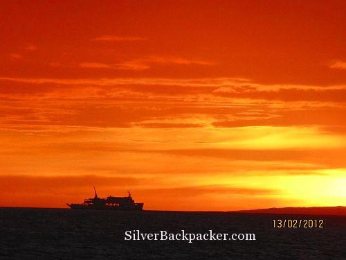 Daily Ferry to Roxas,Mindoro Sails Across the Puka Beach Sunset