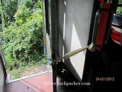 Train to Kuala Lipis door tied open letting in plenty of fresh air