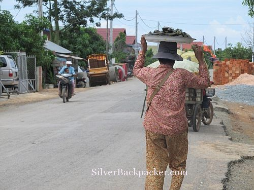 Cambodian woman carrying sticky rice with banana
