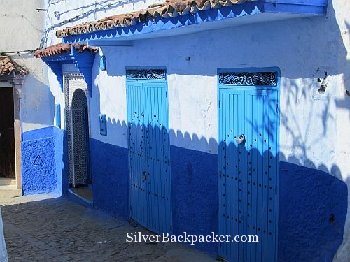 Shadows on Blue doors Chefchaouen