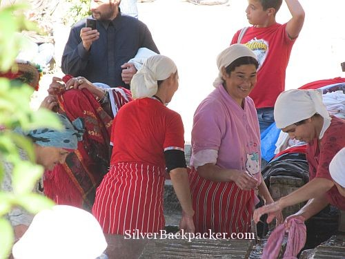 Washer women having a laugh and joke while doing the laundry Chefchaouen