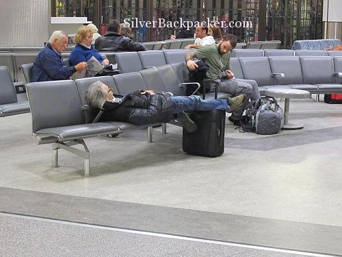 airport sleep feet up