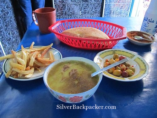 chefchaouen eatery pea soup, chips, olives and bread