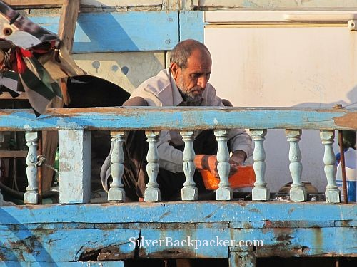 Doing the washing up onboard a Dhow in Dubai Creek