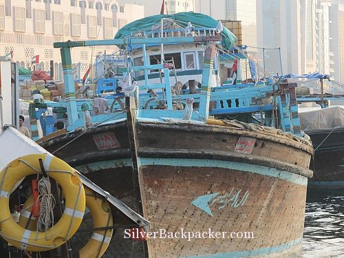 Wooden Dhows docked along Dubai Creek