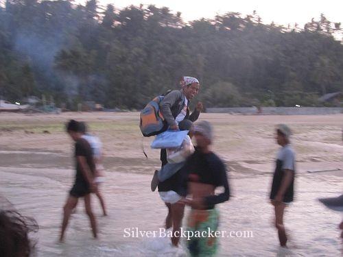 Arnel being carried ashore Caluya