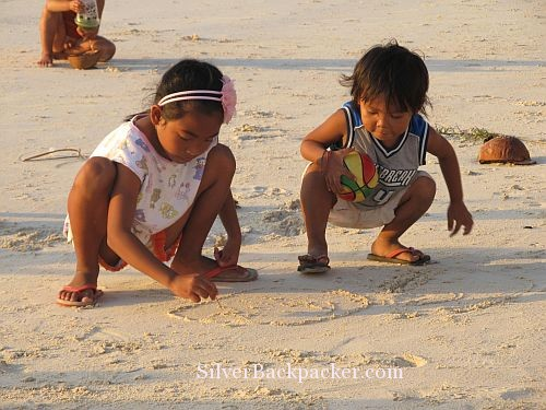 Caluya Drawing in Sand
