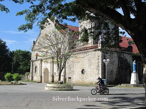pedicab passing San Joaquin church