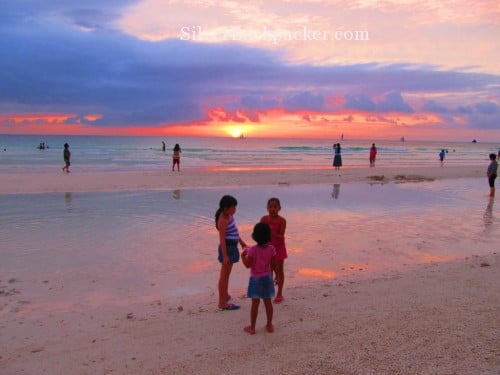 philippine sunsets Boracay White Beach. Cameras are out for the Sunset