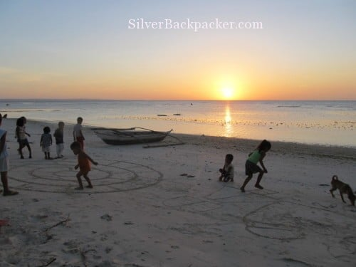 philippine sunsets Caluya children playing on the beach at sunset