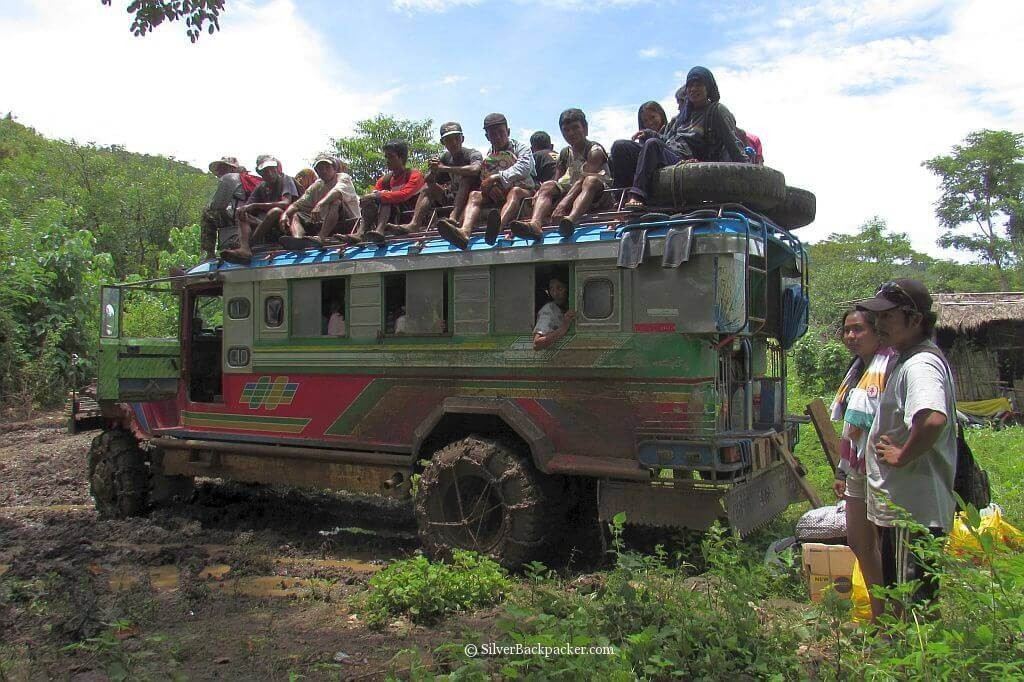 Locals ride the Jeepney Kaparkan Falls Abra
