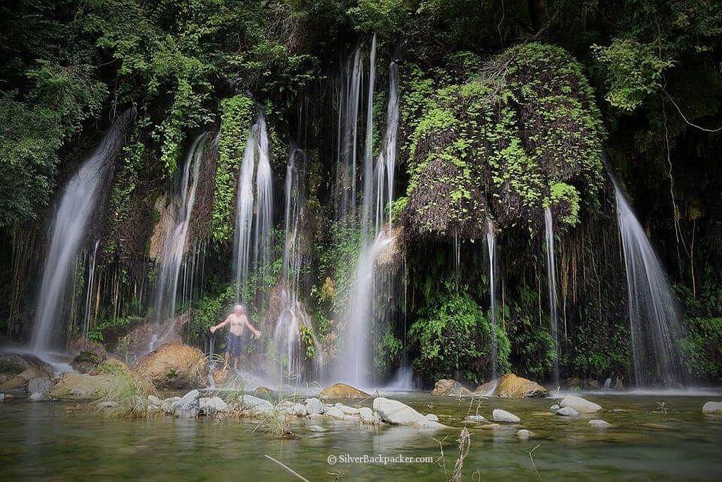 Taking a shower i cascades of Maar-Arbis Falls, Lagayan, Abra