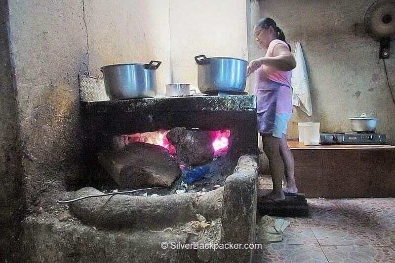 Wood burning fire for cooking Pancit Miki at Acostas Bangued