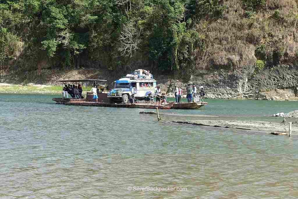Jeepney on ferry river crossing at Luba. How toplan your trip to Abra