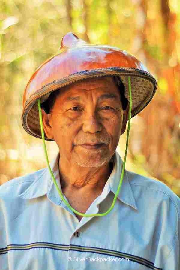 Teofilo Garcia Tabungaw Hat Maker, San Quintin, Abra, Philippines wearing a gourd hat