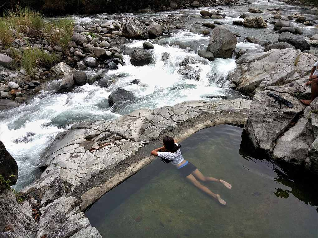 Kili Falls and hotspring. Bathing in hot water.