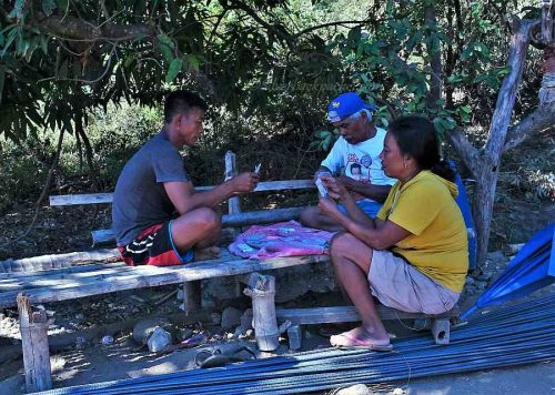 Sunday game of cards in Sitio Ganao, La Paz, Abra
