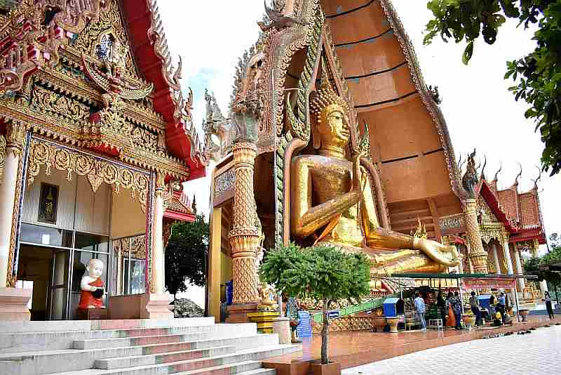Buddha Image with devotees at One of the Temples of Kanchanaburi