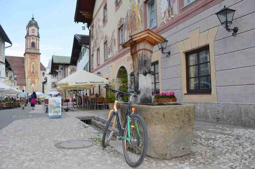 Park up in picturesque towns like Mittenwald, Germany on a cycling holiday