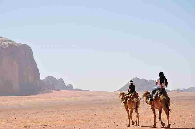 Camel ride in Saudi Arabian desert. Travel with Saudi Arabian Airlines
