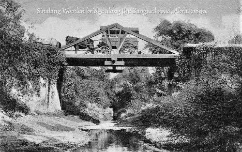 Sinalang Wooden bridge along the Bangued road, Abra. Philippines c1899