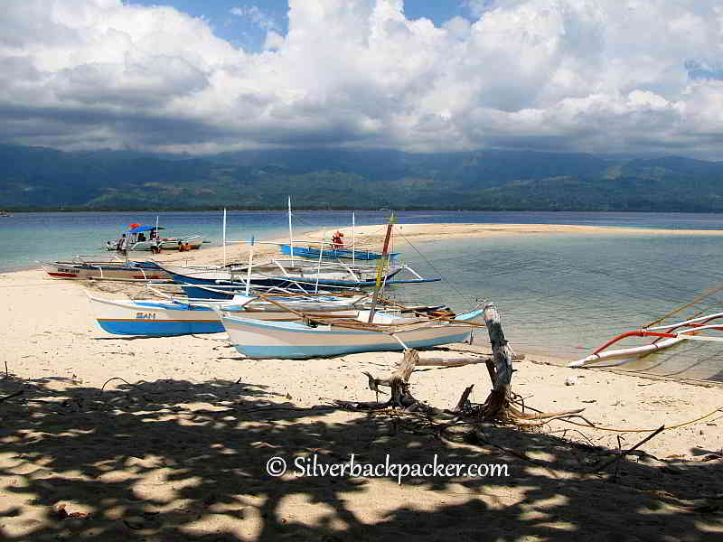Malalison Island. The Sandbar and fishing boats