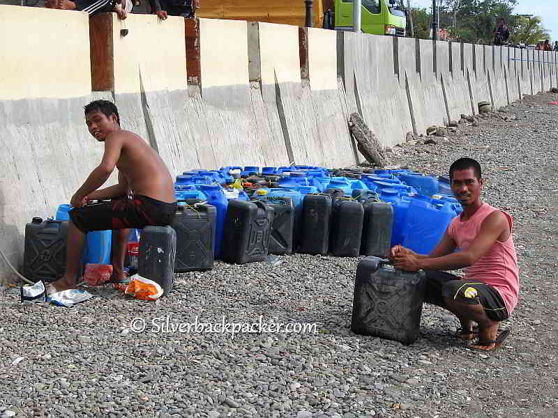refilling containers with drinking water for Malalison Island Culasi, Antique
