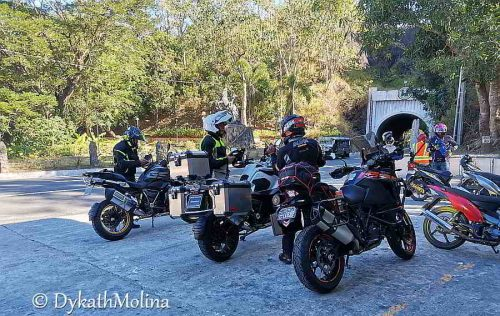 Bikers at Tangadan Tunnel, San Quintin, Abra, Philippines