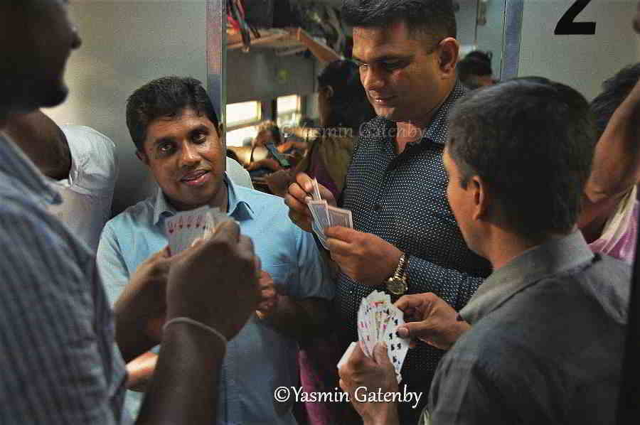 passengers playing cards on a Sri Lanka train