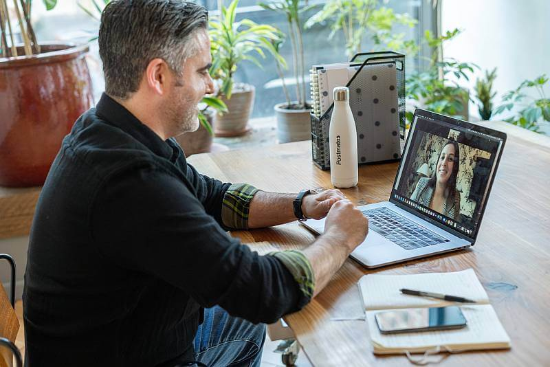 working from home on a virtual call using zoom